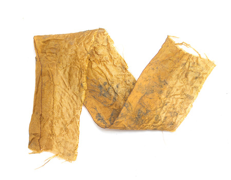 a piece of gold cloth on a white background photo
