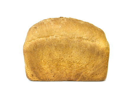 Whole fresh loaf of bread isolated on white photo