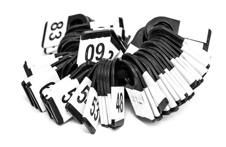 key fob: Some  Keychains and Digits on a white background Stock Photo
