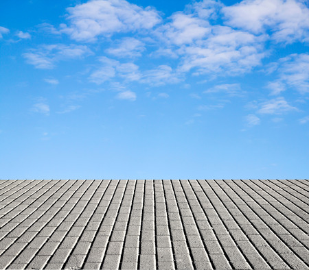 paving stone floor with cloud and blue sky