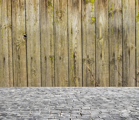 pavement: wooden fence rough background and vintage stone pavement foreground Stock Photo