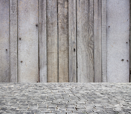 the workpiece: wooden fence rough background and vintage stone pavement foreground Stock Photo