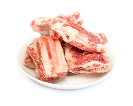 a piece of frozen meat on a white background photo