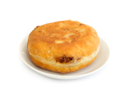 fried pies with meat on a white background