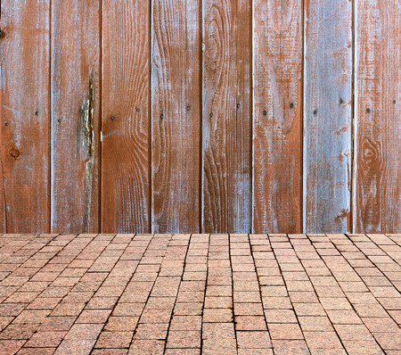 stone pavers on the background of wooden wall photo