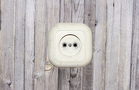 old white socket on a wooden background photo