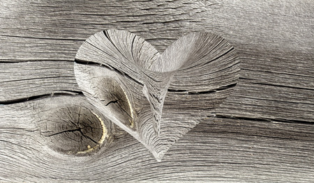 wooden heart on a wooden background photo