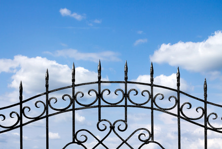forged metal fence against the sky photo