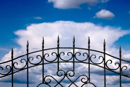 ancient blacksmith: forged metal fence against the sky