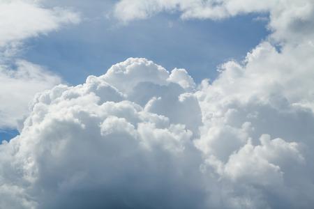 cumulus clouds and a blue sky background