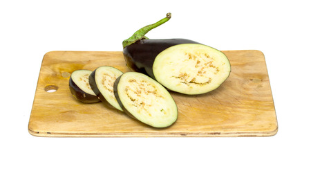 Raw aubergines or eggplants on wooden backround photo