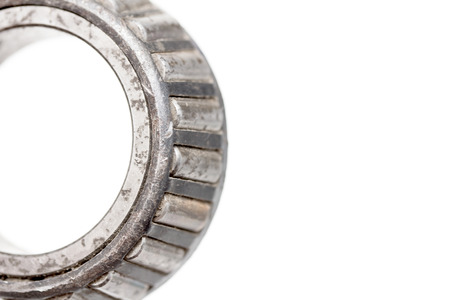 chromium plated: old roller bearing with traces rust, isolated on white background.