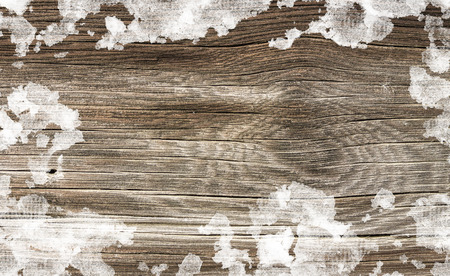 wooden background in snow surface photo