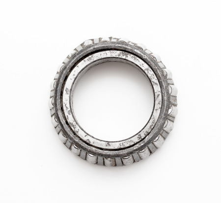 chromium plated: old roller bearing with traces rust, isolated on white .