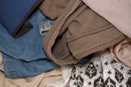 old items: pile of old clothing items Stock Photo