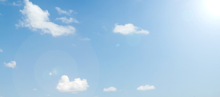 light blue background: Cloudy sky with bright sunshine Stock Photo