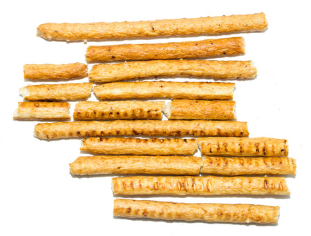 pretzel stick: salted bread sticks on white background
