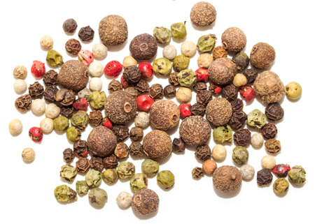 rich flavor: Round pepper on a white background, spices