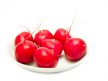 red radish on a plate on a white background photo