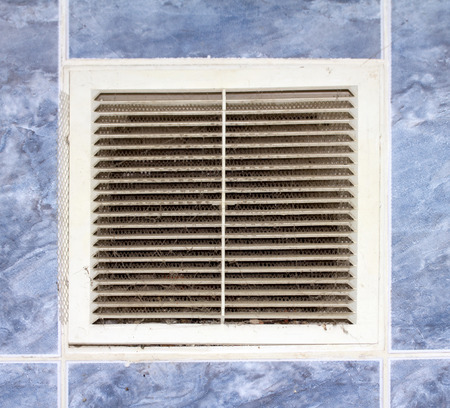 mesh grille in the wall ventilation photo
