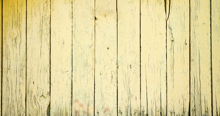 wooden desk: old wooden fence with yellow paint