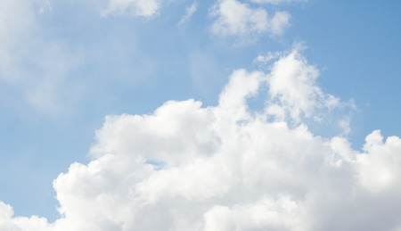 which: the dark blue sky on which there are white clouds