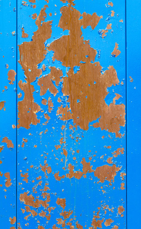 rust red: metal painted blue with red rust