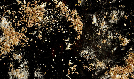 crumbing: leftovers on a black background