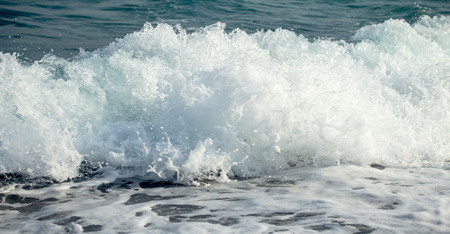 sea wave: Sea wave foam on the pebble beach. Stock Photo