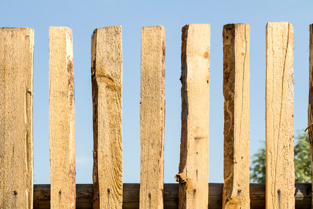 rickety: old rickety wooden fence with a view of the sky