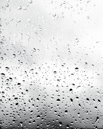 inclined: Drops of rain on the inclined window (glass).