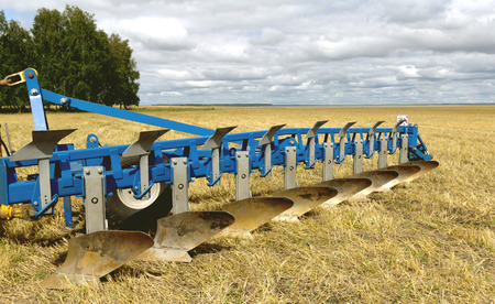 agriculture machinery: plow on the field ready to work