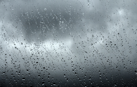 rain weather: Drops of rain on glass