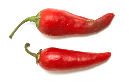 chiles picantes: Red hot peppers isolated on white background Foto de archivo
