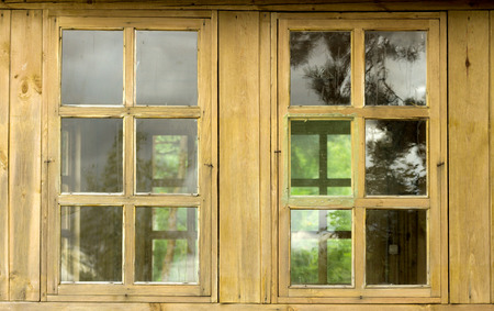 logs: window in a wooden house made of logs