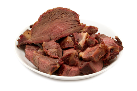 horseflesh: appetizing meat, smoked horse meat on a white background