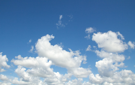 beautiful scenery: textured white cumulus clouds in the blue sky Stock Photo