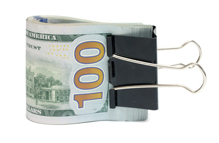 heap of dollar: US dollars on a white background
