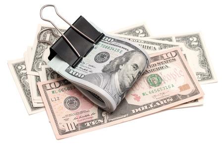 dolar: Dólares estadounidenses sobre un fondo blanco Foto de archivo