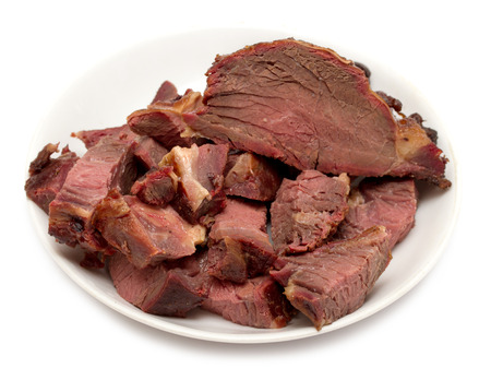 horse meat: appetizing meat, smoked horse meat on a white background