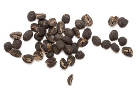 invigorate: dark seeds boiled coffee on a white background