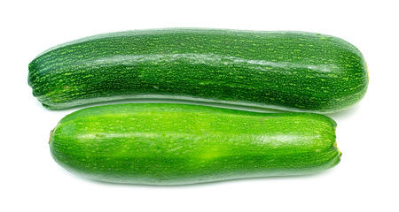 phallic: ripe green zucchini on a white background