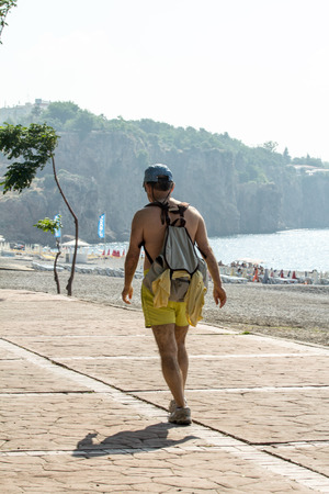 vacationers: tourists, vacationers strolling near the sea Editorial