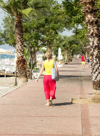 vacationers: tourists, vacationers strolling near the sea Stock Photo