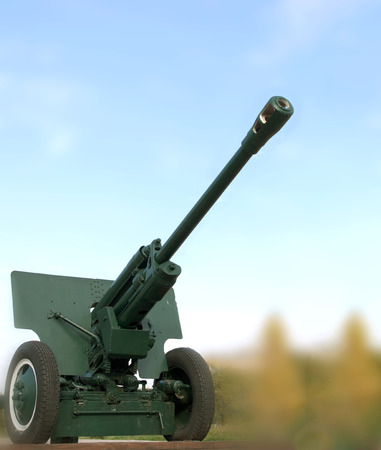 wwii: cannon gun from WWII against the sky