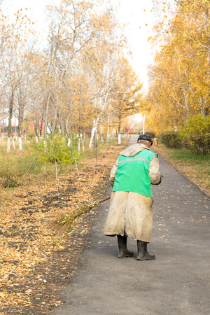 janitor: janitor sweeps the street, autumn