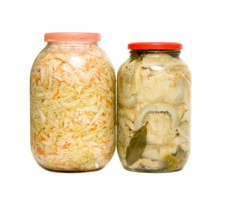 preserve: Glass jars with mushroom and cabbage