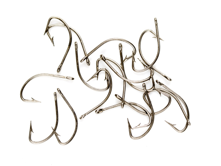 Steel fishing hooks on a white background