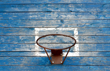 iron hoops: Wooden old basketball backboard on the street