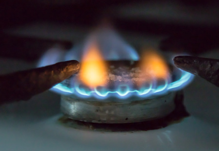 gas stove: Gas burner on stove. Selective focus. Stock Photo